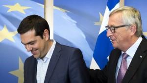 De Griekse premier Tsipras en voorzitter Juncker van de Europese Commissie.